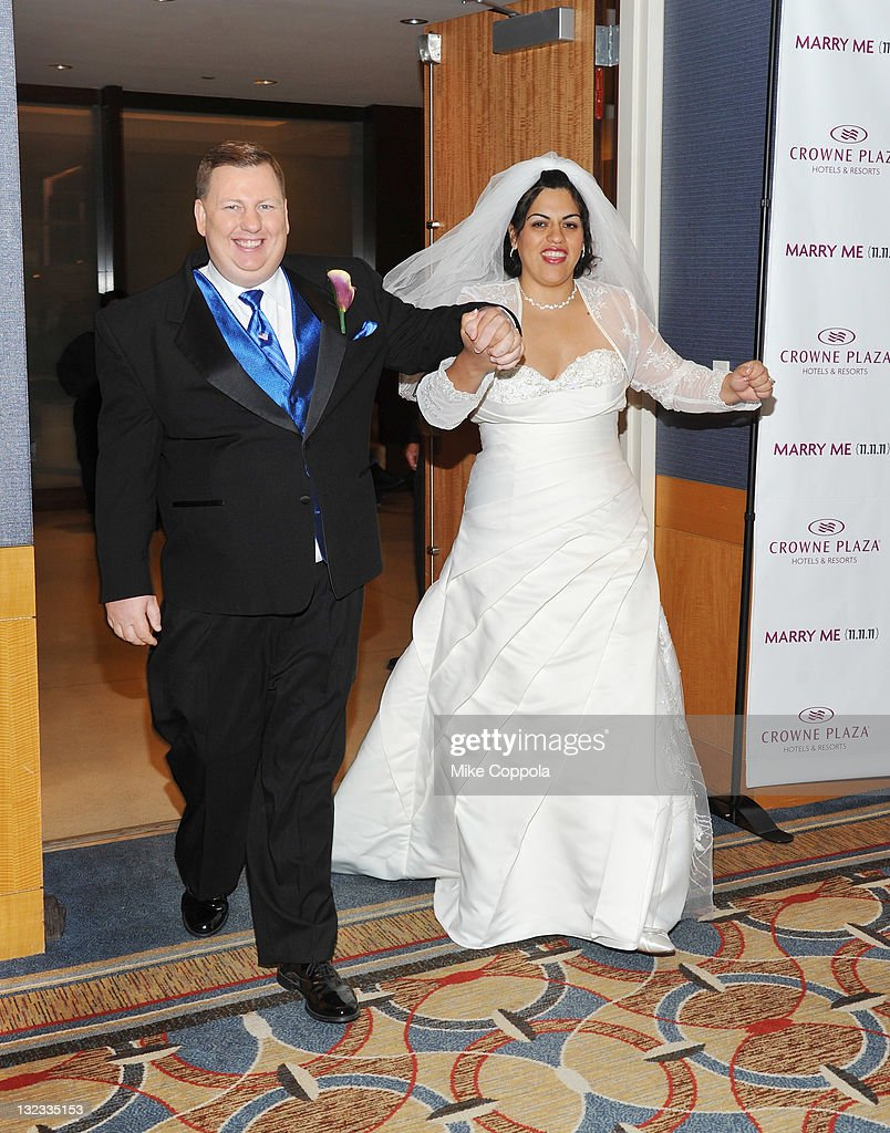 Mr. and Mrs. Dan and Myrna Wilkins pose at a wedding for 11 couples at the Crowne Plaza Times Square on November 11, 2011 in New York City.