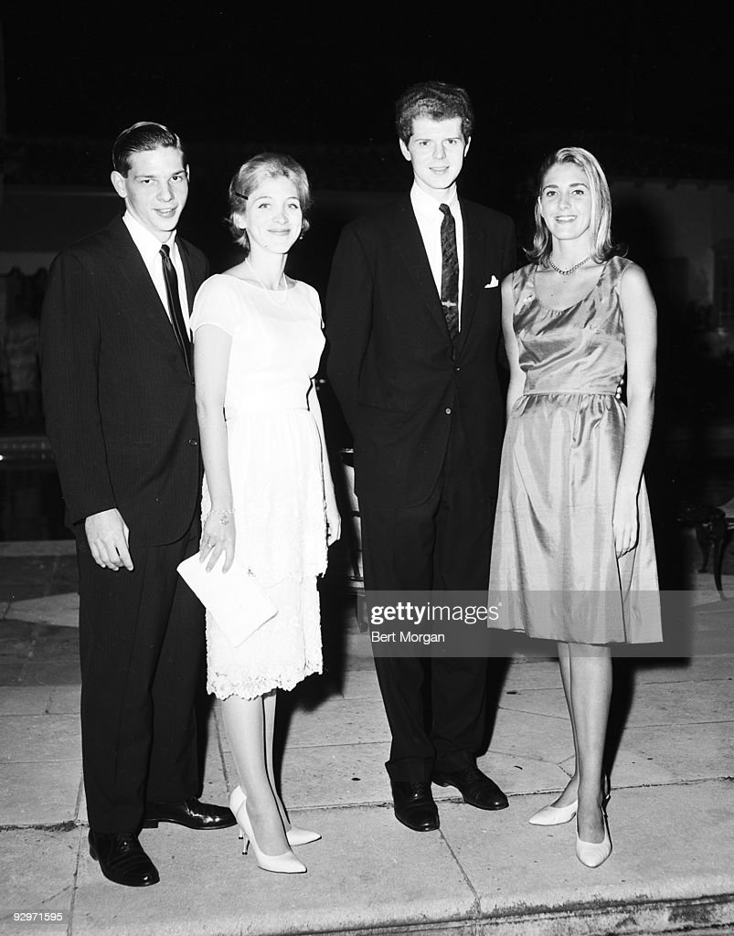 Mr and Mrs Frank Roberts poising with Van Cliburn and Mary Obelensky on a patio at Mr and Mrs Frank McMahon's party honoring Van Cliburn Palm Beach...