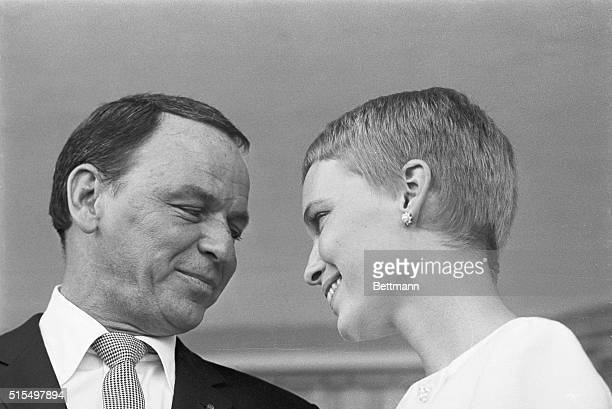 Mr and Mrs Frank Sinatra exchange fond glances following their wedding on July 19 at the Sands Hotel in Las Vegas
