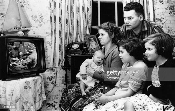 Mr and Mrs Freeman and their children watching a BBC documentary programme about Mrs Freeman's Caesarian section operation entitled 'Your Life in...