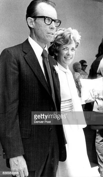 Mr and Mrs Harry Buchenau pause outside the Roman Catholic Church of the Risen Christ following the nuptials of her daughter Nancy Allis and Robert...
