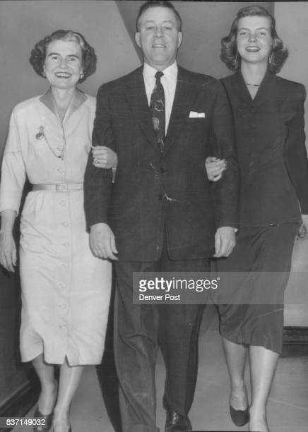 Mr and Mrs John A Carroll and daughter Diane make a happy threesome after Carroll announced his decision to seek the Democratic senatorial nomination...