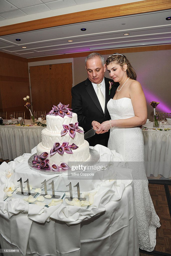 Mr. and Mrs. Lazaro and Tania Serpa pose at a wedding for 11 couples at the Crowne Plaza Times Square on November 11, 2011 in New York City.