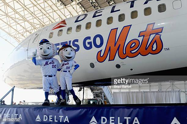 Mr and Mrs Met pose onstage at Delta Air Lines' unveiling of the 'Let's Go Mets' aircraft at JFK Airport to celebrate the team's return to the...