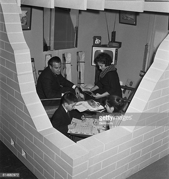 Mr and Mrs Nathaniel Schaffaud and their children Eric and Diane settle into a deluxe fallout shelter on display at Civil Defense headquarters in New...