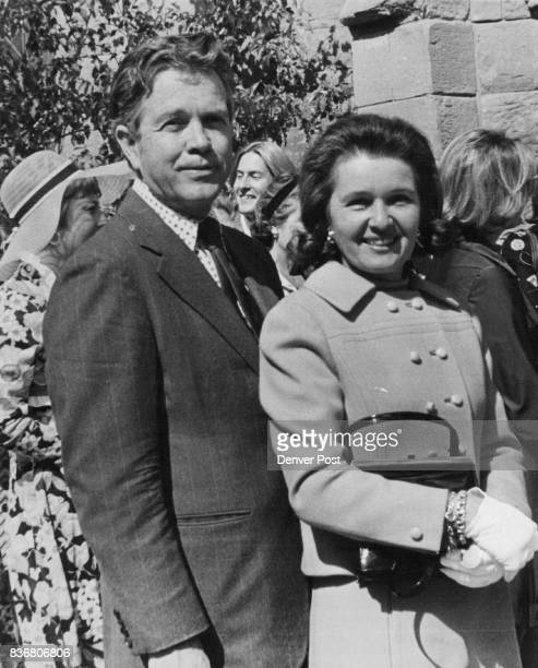 Mr and Mrs Robert B Wilson pause in front of Evans Memorial Chapel on the University of Denver campus after recent earlyafternoon autumn wedding of...