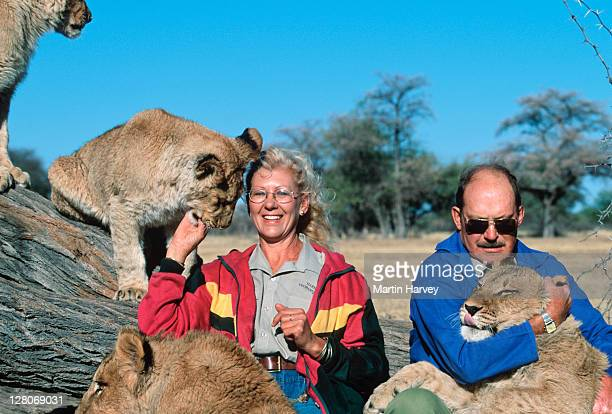 Mr and Mrs van der Merwe with orphaned lions Harnas Wildlife Foundation Namibia, Southern Africa