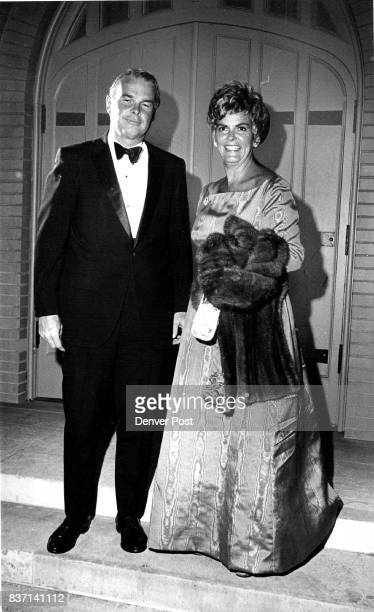 Mr and Mrs Walter Steele pause in front of the Episcopal Church of the Ascension where they attended a recent wedding Mrs Steele wore a water taffeta...