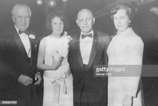 Mr and Mrs William E Barrett left exchange predinner talk with Dr and Mrs Eugene Dawson at Brown Palace Hotel Sunday night The event honored novelist...