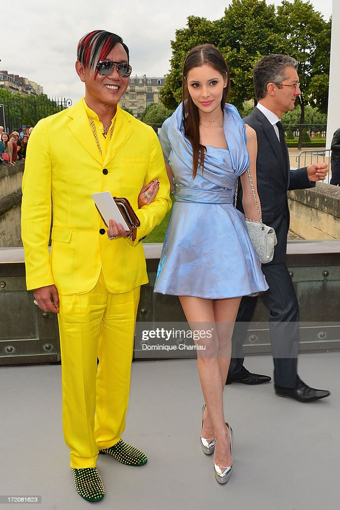 Mr and Ms Hung attend the Christian Dior show as part of Paris Fashion Week Haute-Couture Fall/Winter 2013-2014 at on July 1, 2013 in Paris, France.