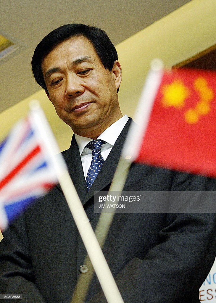Mr. <a gi-track='captionPersonalityLinkClicked' href=/galleries/search?phrase=Bo+Xilai&family=editorial&specificpeople=225006 ng-click='$event.stopPropagation()'>Bo Xilai</a>, Chinese Minister of Commerce looks on during the announcement of British companies BP, Shell, Kingfisher and B&Q's new joint ventures in China 11 May 2004 at the DTI Conference Center in London. AFP PHOTO/Jim WATSON
