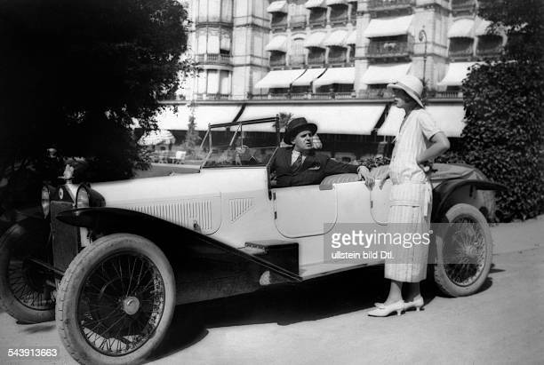 Mr Brenner at the wheel of his Lancia car with his wife during the motor race in BadenBaden Photographer Atelier Binder Published by 'Die Dame'...