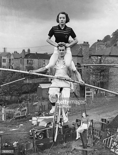 Mr Charles Davis and his son are giving up their jobs in the mines to join a family travelling troupe They practice high wire cycling in their back...