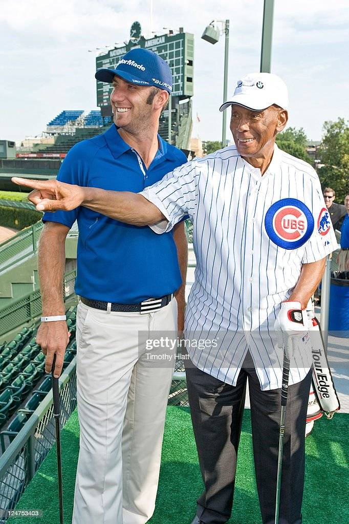 'Mr. Cub' Ernie Banks shows BMW Championship defending champion Dustin Johnson how to call his shot the way Babe Ruth did after participating in a historic challenge in which the pair attempted to make a hole-in-one in order to earn a $100,000 college scholarship for the Evans Scholars Foundation, a Chicago-based charity.at Wrigley Field on September 12, 2011 in Chicago, Illinois.