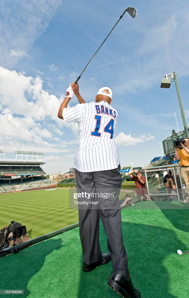 'Mr. Cub' <a gi-track='captionPersonalityLinkClicked' href=/galleries/search?phrase=Ernie+Banks&family=editorial&specificpeople=167021 ng-click='$event.stopPropagation()'>Ernie Banks</a> tees off from a specially-constructed platform in the stands at Wrigley Field to mark the start of the 2011 BMW Championship. Banks joined BMW Championship defending champion Dustin Johnson in a historic challenge in which the pair attempted to make a hole-in-one in order to earn a $100,000 college scholarship for the Evans Scholars Foundation, a Chicago-based charity.on September 12, 2011 in Chicago, Illinois.