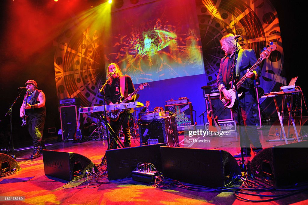 Mr Dibs, Dave Brock and Niall Hone of Hawkwind performs on stage at Shepherds Bush Empire on December 10, 2011 in London, England.