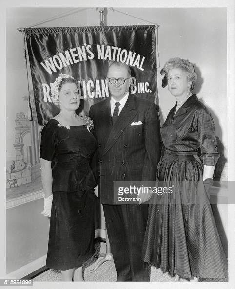 Mr Ezra Taft Benson Secretary of Agriculture standing with Mrs Edward Anderson and Mrs Edwin J Hilson at the Women's National Republican club are...