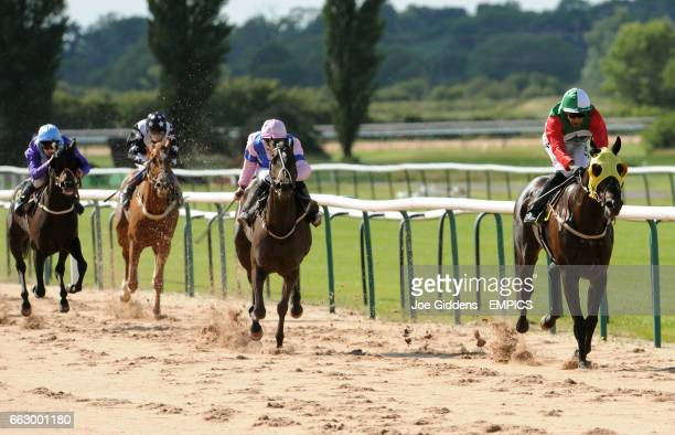 Mr Fantozzi ridden by Saleem Golam leads the pack down the home straight in the Rosemary Heron Memorial Handicap