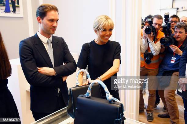 Mr Gauthier Destenay and French First Lady Mrs Brigitte Macron are pictured during the visit of the partners of the heads of state and Government at...
