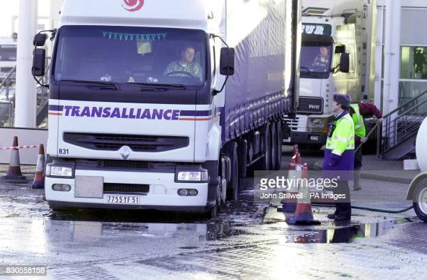 Mr Gordon Barnett the team leader of Freight Operations at the Euro Tunnel port checks that lorries onroute to the Continent are driven through a...