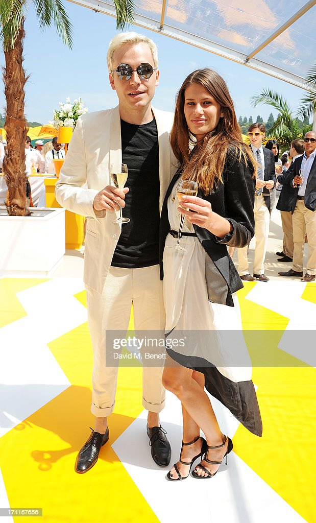 Mr Hudson (L) and Holly Grace attend the Veuve Clicquot Gold Cup Final at Cowdray Park Polo Club on July 21, 2013 in Midhurst, England.