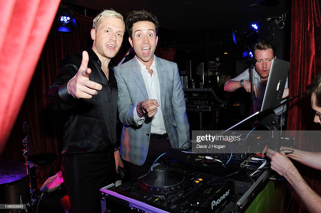 L-R Mr Hudson and Nick Grimshaw DJ at the UK Creatives Drinks Reception celebrating media, arts, sport and creativity in the UK at Dover Arts Club on July 30, 2012 in London, England.