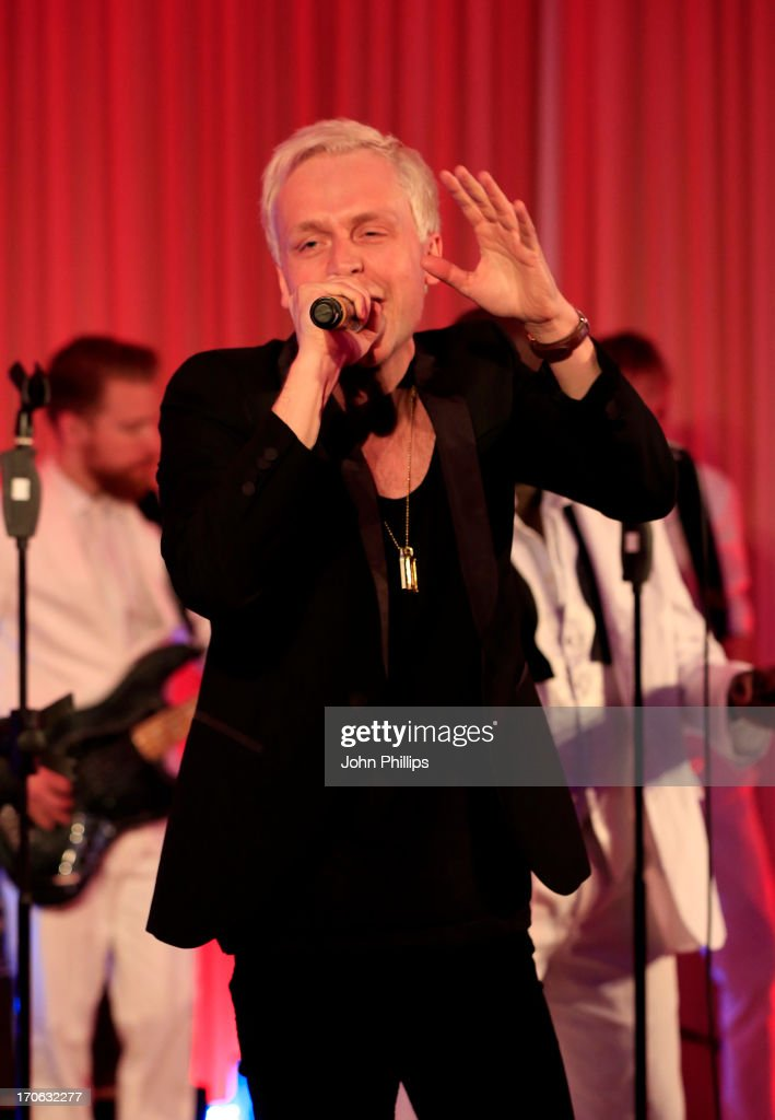 Mr Hudson performs during the Affinity Real Estate Shooting Stars Benefit closing Ball at The Grove Hotel on June 15, 2013 in Hertford, England.