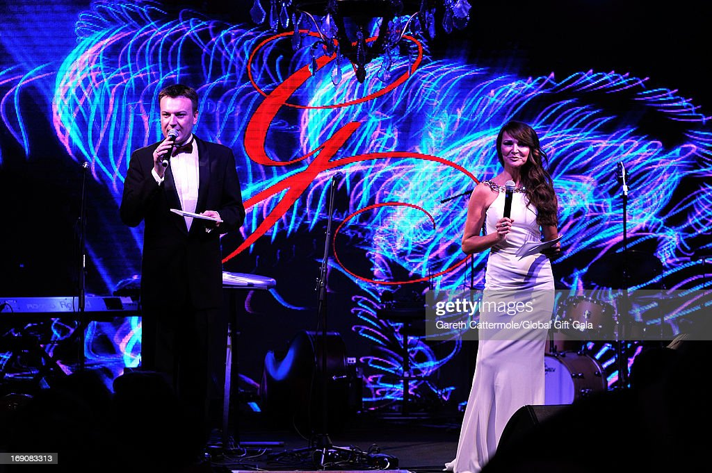 Mr Igor Lychev and Lizzi Cundy on stage during the 'Global Gift Gala' 2013 dinner and auction presented by <a gi-track='captionPersonalityLinkClicked' href=/galleries/search?phrase=Eva+Longoria&family=editorial&specificpeople=202082 ng-click='$event.stopPropagation()'>Eva Longoria</a> at Carlton Hotel on May 19, 2013 in Cannes, France.