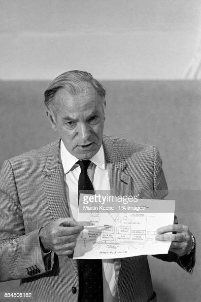 Mr John Brading Chairman and Chief Executive Officer of Occidental Petroleum Ltd referring to a diagram of the Pipertype of oil platform at a press...