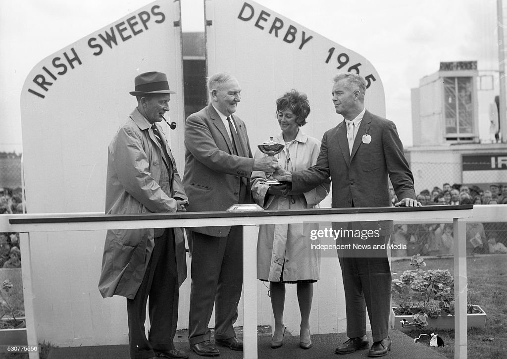 Mr Joseph McGrath presenting the Irish Sweeps Derby trophy to Mr G M Bell one of the coowners of Meadow Court after its success at the Curragh on...