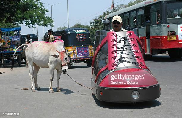 Mr K Sudhakar rides a shoe car outside the Sudha Cars Museum He is a Guinness World Record holder for making the Largest Tricycle in the World