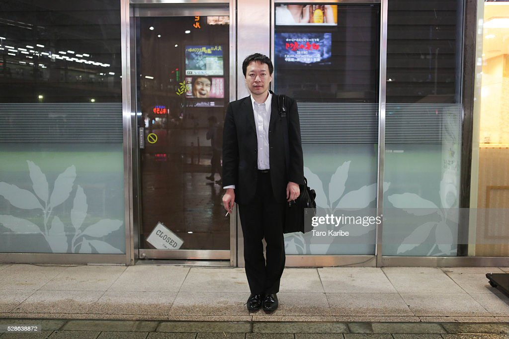 Mr. Kanezashi poses for portraits. He was asked what he look forward to during the week and when on holiday, on week days he looks forward to getting good result on their work and for holiday he looks forward to taking care of his family on May 06, 2016 in Tokyo.