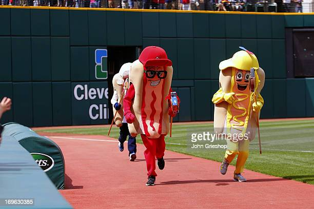 Mr Ketchup leads the Hot Dog Race during the game between the Cleveland Indians and the Minnesota Twins on May 4 2013 at Progressive Field in...