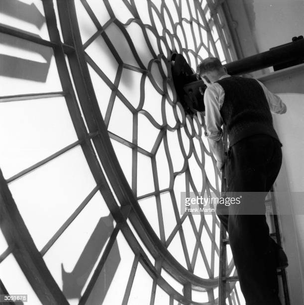 Mr King examining the clock face of Big Ben in Clock Tower of the Houses of Parliament London