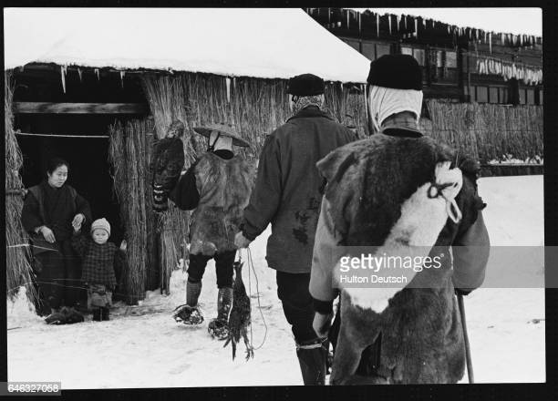 Mr Kutsakake and fellow Japanese hunters return to their strawinsulated home with a rabbit and a pheasant enough for a full winter meal for the...