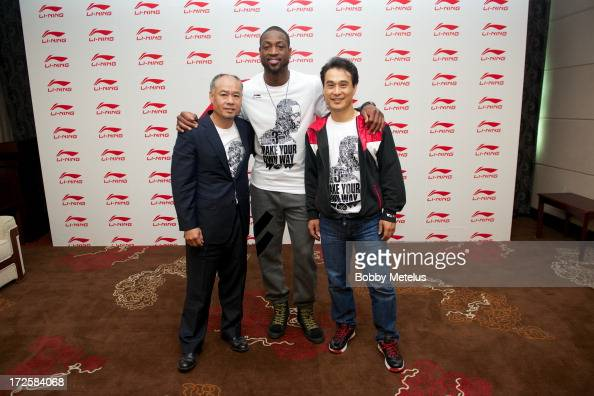 Mr Li Ning Dwyane Wade and Kin JinGoon Dwyane Wade attend the WOW meet and greet on July 3 2013 in Beijing China