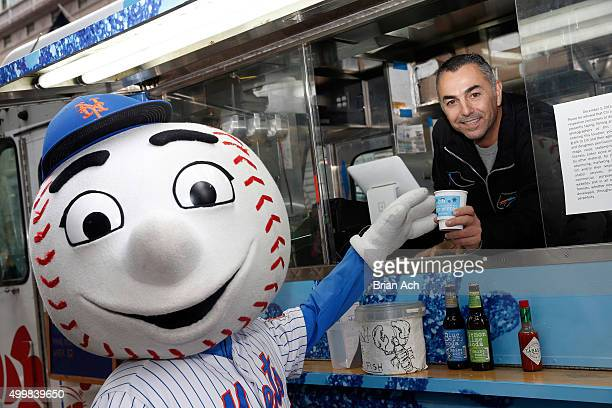 Mr Met and former Major League Baseball pitcher John Franco attend Citi Offers Sweet Treats to New Yorkers on December 3 2015 in New York City