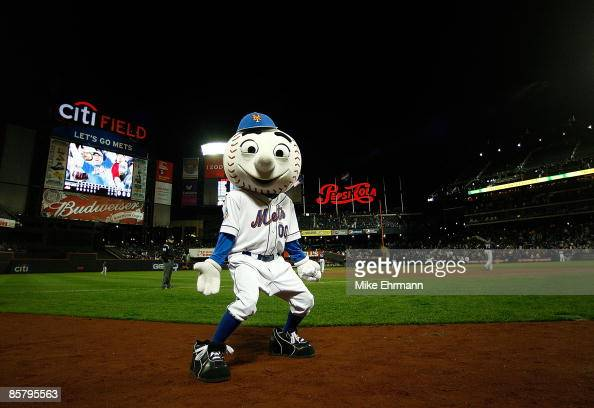Mr Met gets the crowd going during an exhibition game between the New York Mets and the Boston Red Sox on April 3 2009 at Citi Field in the Flushing...