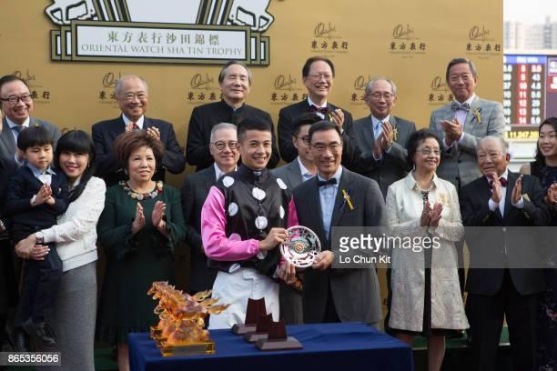 Mr Michael TH Lee Steward of the Hong Kong Jockey Club presents the The Oriental Watch Sha Tin Trophy silver dish to jockey Derek Leung at Sha Tin...