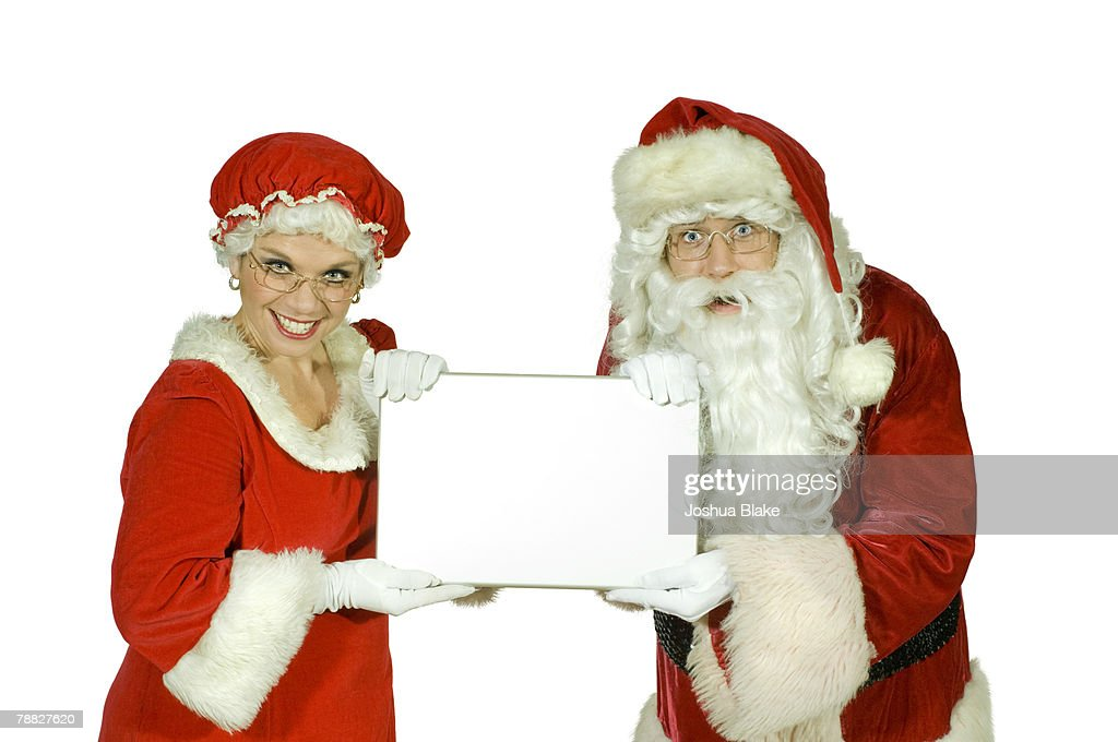 Mr Mrs Claus Hold Laptop Computer Between Them Stock Photo