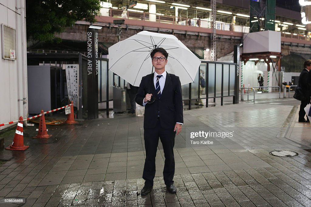 Mr. Nakanishi works for educational company poses for portraits. He was asked what he looks forward to during the week and when on holiday, on week days he looks forward to nothing really and for holiday he looks forward to nothing really as well on May 06, 2016 in Tokyo.
