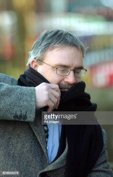 Mr Nelson Bland shields his face as he arrives at Nottingham Crown Court Mr Bland is the lover of Carol Croydon an accountant who allegedly attacked...