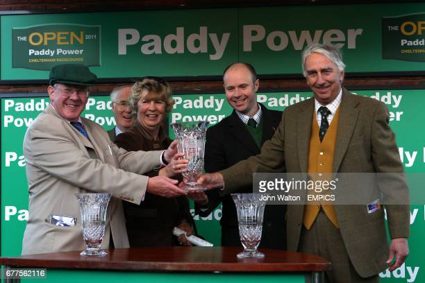 Mr Paul Barber partowner of Rangitoto accepts the winning trophy for the Paddy Power Mobile Intermediate Handicap Hurdle