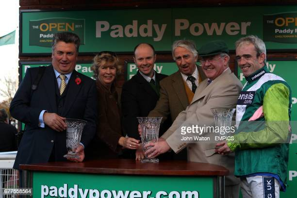 Mr Paul Barber partowner of Rangitoto Jockey Ruby Walsh and Trainer Paul Nicholls pose with their trophies after winning the Paddy Power Mobile...