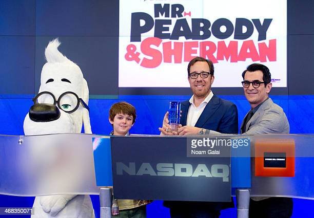 Mr Peabody Actor Max Charles Director Rob Minkoff and Actor Ty Burrell of DreamWorks' 'Mr Peabody And Sherman' ring the opening bell at NASDAQ...