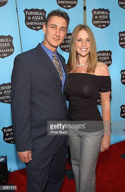 Mr Personality television contestants Will Dyck and Haley Arp attend the grand opening reception of the new Turnbull and Asser store on June 4 2003...