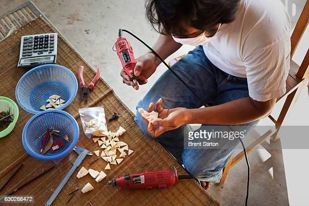 Mr Ramet Yeerum a master ivory carver at work in a small village close to Surin Elephant Village in Surin Thailand November 10 2011 Mr Yeerum stated...