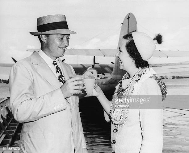 Mr RJ Reynolds of Winston Salem NC greets his first wife Elizabeth McGaw Dillard at the Pearl Harbor Clipper base in Honolulu She flew to meet him...