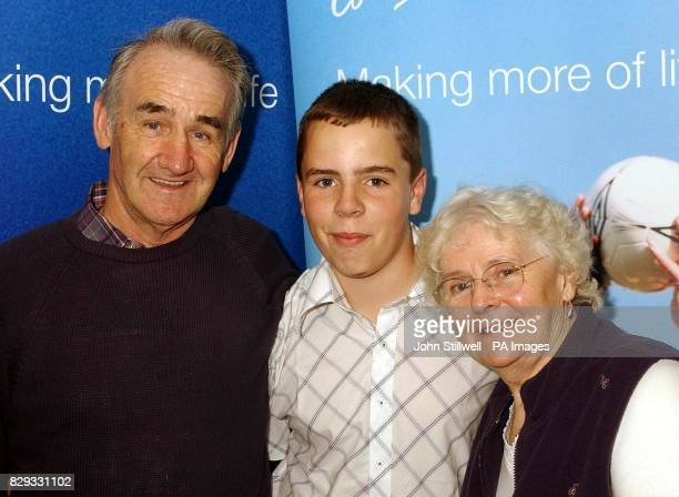 Mr Sammy Gibson and his wife Dawn 66 from Cornwall with their grandson Sam Ryan who nominated them They are finalists in the Age Concern's...