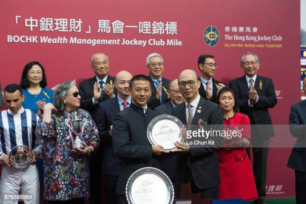 KONG NOVEMBER Mr Terry Lo Kin Wing Chief Executive of the BOC Group Life Assurance Company Limited presents a silver dish to winning trainer Danny...
